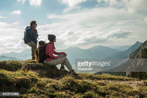 Austria, Tyrol, Tannheimer Tal, young couple resting on hiking tour