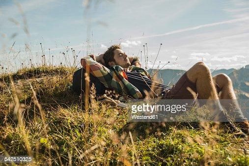 Austria, Tyrol, Tannheimer Tal, young hiker having a rest