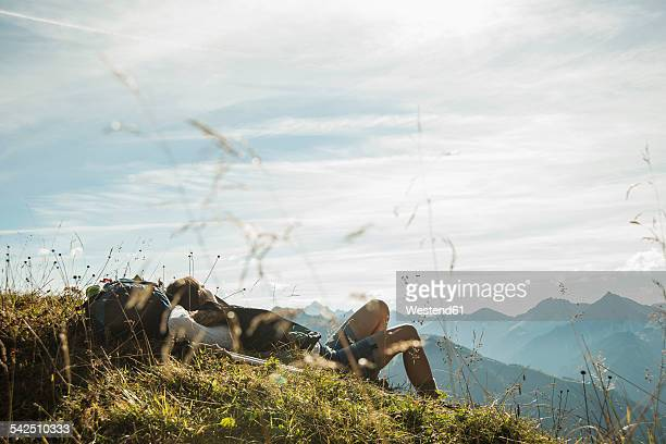 Austria, Tyrol, Tannheimer Tal, young hiker having a rest