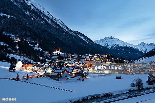 Austria, Tyrol, view on Ischgl in winter at dusk