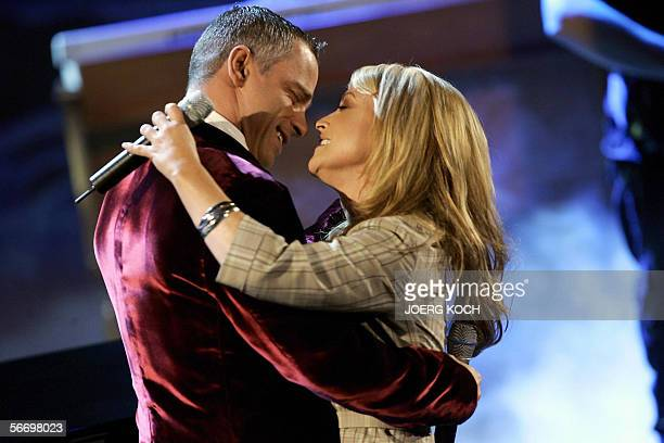 US pop star Anastacia and Italian singer Eros Ramazotti perform during the live broadcast of the TV show 'Wetten dass ' 28 January 2006 in Salzburg...