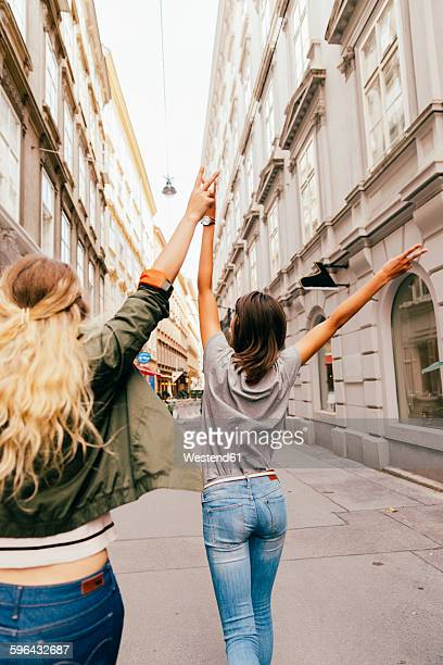 Austria, Vienna, back view of two female friends exploring the old town
