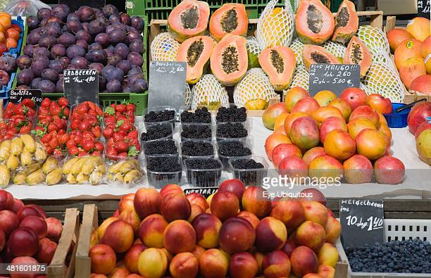 Austria Vienna Display of fresh fruit for sale on market stall including plums strawberries papaya mango and nectarines