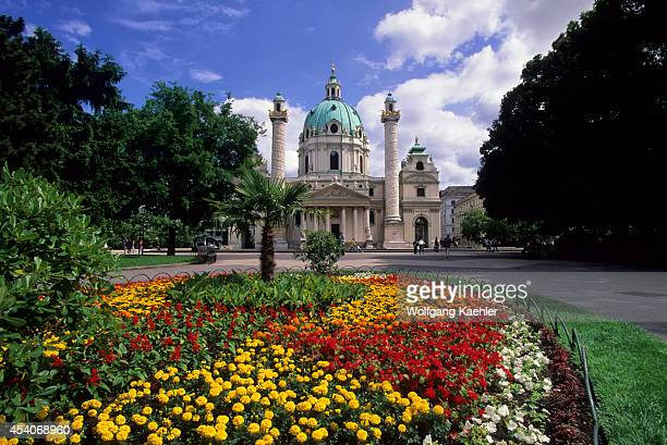 Austria Vienna Karlskirche Baroque Architecture Flowers In Foreground