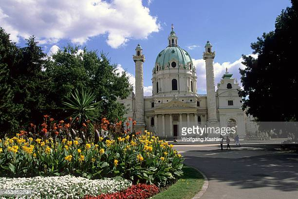 Austria Vienna Karlskirche Flowers In Foreground