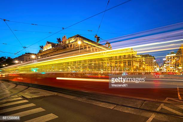 Austria, Vienna, opera square with passing tramway at blue hour