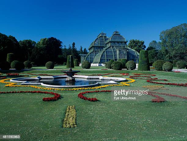 Austria Vienna Schonbrunn Palace formal gardens with fountain and the Palm House