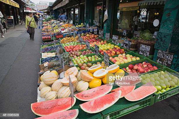 Austria Vienna The Naschmarkt Display of fresh fruit for sale on stall outside shop front including apples melon and pineapple