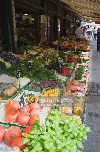 Austria Vienna The Naschmarkt Display of fresh fruit vegetables and herbs for sale outside shop front under awning