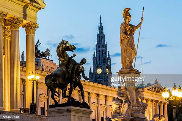 Austria, Vienna, view to parliament building, town hall tower and statue of goddess Pallas Athene by twilight
