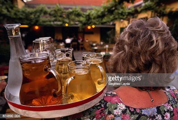 Austria, Vienna, waitress in Heuriger (traditional wine tavern)