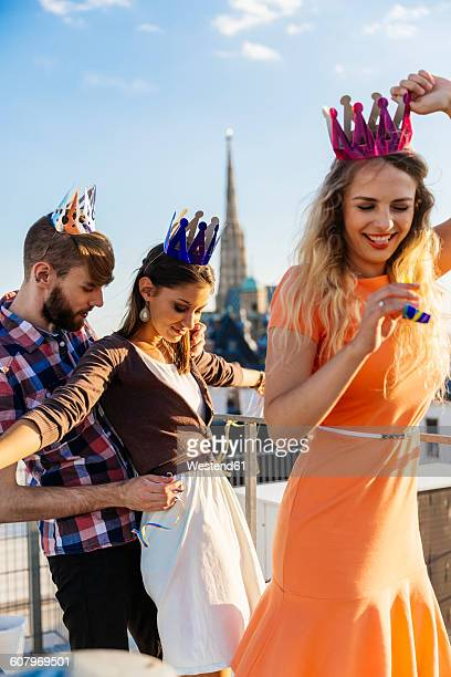 Austria, Vienna, Young people having a party on rooftop terrace