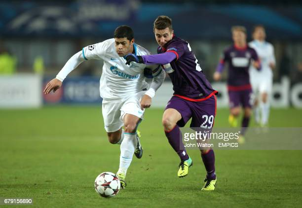 Austria Vienna's Markus Suttner and Zenit St Petersburg's Hulk battle for possession of the ball