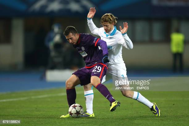 Austria Vienna's Markus Suttner shields the ball from Zenit St Petersburg's Cristian Ansaldi
