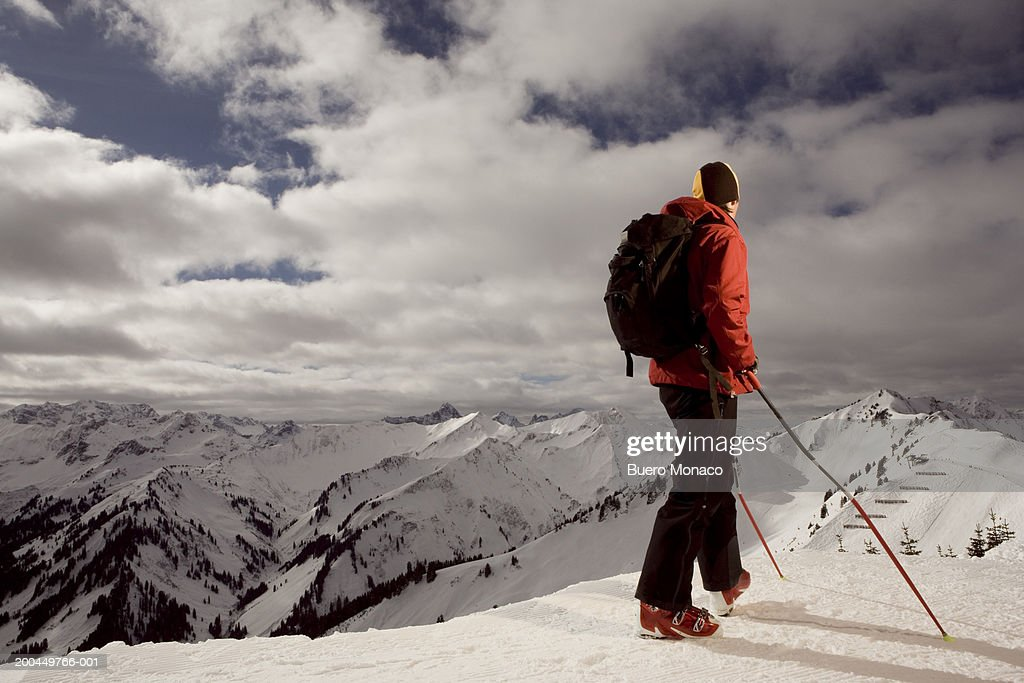 Austria, Vorarlberg, man standing on peak in mountainous landscape : Stock Photo