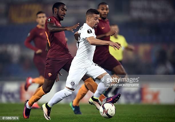Austria Wien's Brazilian midfielder Lucas Venuto challenges AS Roma's Brazilian defender Gerson during the UEFA Europa League group E football match...