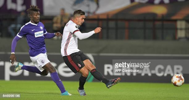 Austria Wien's defender from Ghana Abdul Kadiri Mohammed fails to stop AC Milan's forward from Portugal Andre Silva from scoring the 41 goal during...