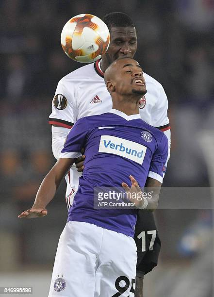 Austria Wien's forward from Brazil Felipe Pires and AC Milan's defender from Colombia Cristian Zapata vie for the ball during the UEFA Europa League...