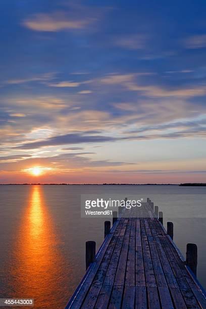 Austria,Burgenland, View of dock on Lake Neusiedl at sunrise