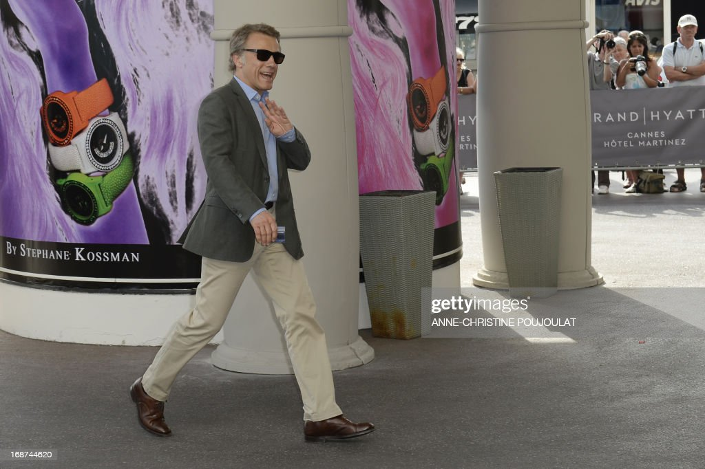 Austrian actor and member of the Feature Film Jury Christoph Waltz waves on May 14, 2013 as he arrives at the Martinez Hotel in Cannes to attend a photocall of the Jury on the eve of the 66th edition of the Cannes Film Festival. Cannes, one of the world's top film festivals, opens on May 15 and will climax on May 26 with awards selected by a jury headed this year by Hollywood legend Steven Spielberg. AFP PHOTO / ANNE-CHRISTINE POUJOULAT