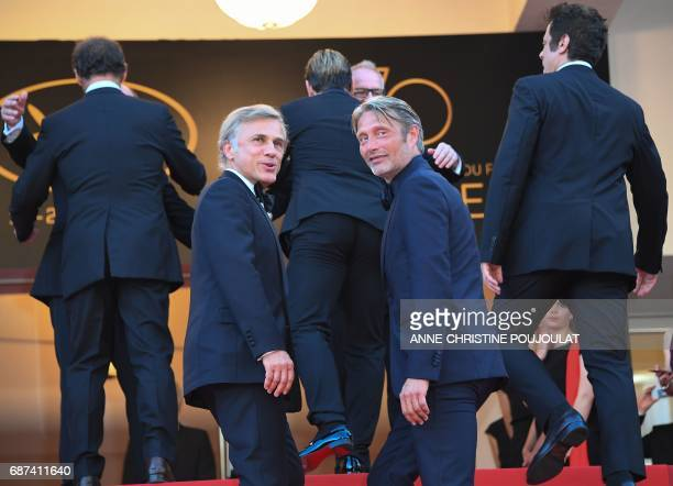 Austrian actor Christoph Waltz and Danish actor Mads Mikkelsen arrive on May 23 2017 for the '70th Anniversary' ceremony of the Cannes Film Festival...