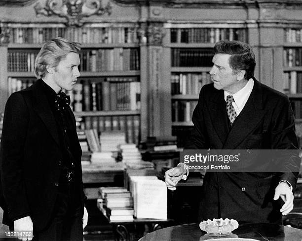 Austrian actor Helmut Berger and American actor Burt Lancaster acting in the film 'Conversation Piece' Rome 1974