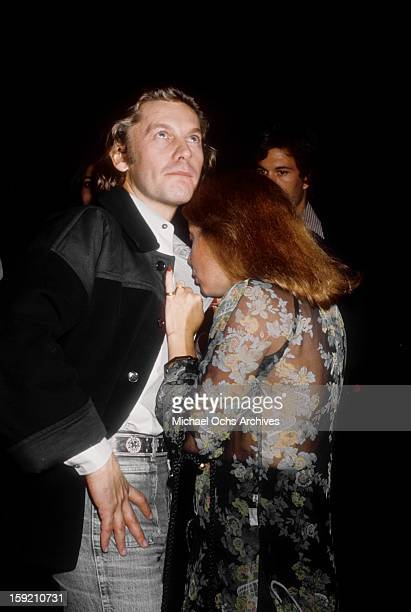 Austrian actor Helmut Berger and friend outside 'My Place' nightclub on November 15 1976 in Los Angeles California