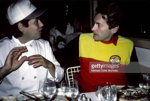 Austrian actor Helmut Berger is joined at his table by celebrity chef Wolfgang Puck at his restaurant 'Spago' in November 1983 in Los Angeles...