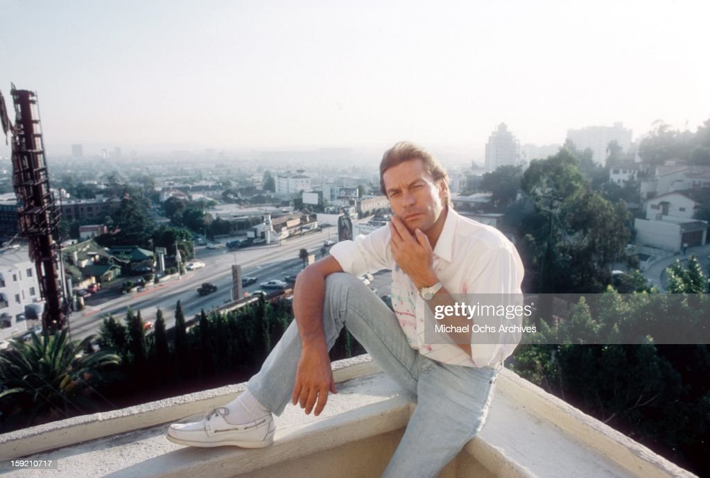 Austrian actor Helmut Berger poses for a portrait at The Chateau Marmont Hotel in October 1983 in Los Angeles California