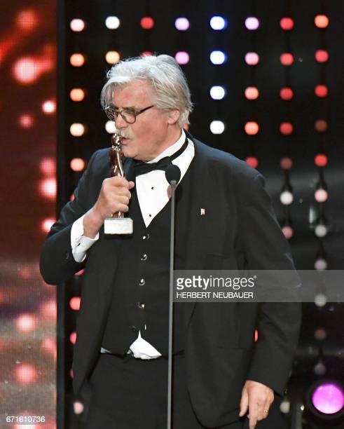 Austrian actor Peter Simonischek receives the 'Platin Romy Award' during the Romy Gala 2017 in Vienna on April 22 2017 The Romy is a TV award in...