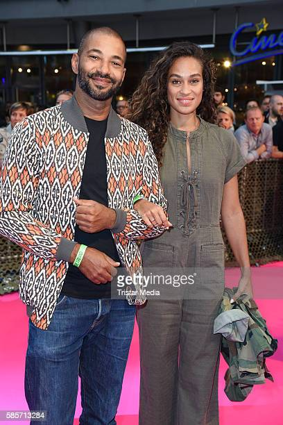 Austrian actor Tyron Ricketts and his girlfriend Vivian Burkhardt attend the Suicide Squad Live Event at CineStar on August 3 2016 in Berlin Germany