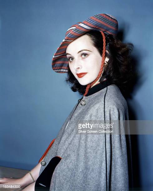 Austrian actress Hedy Lamarr in a grey cape and a striped hat circa 1940