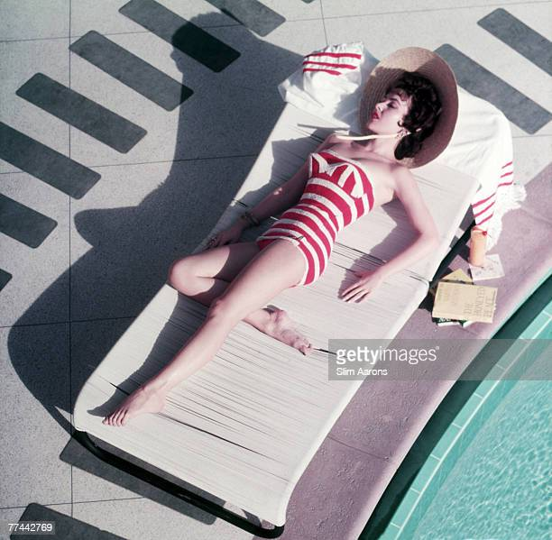 Austrian actress Mara Lane lounging by the pool in a red and white striped bathing costume at the Sands Hotel Las Vegas 1954