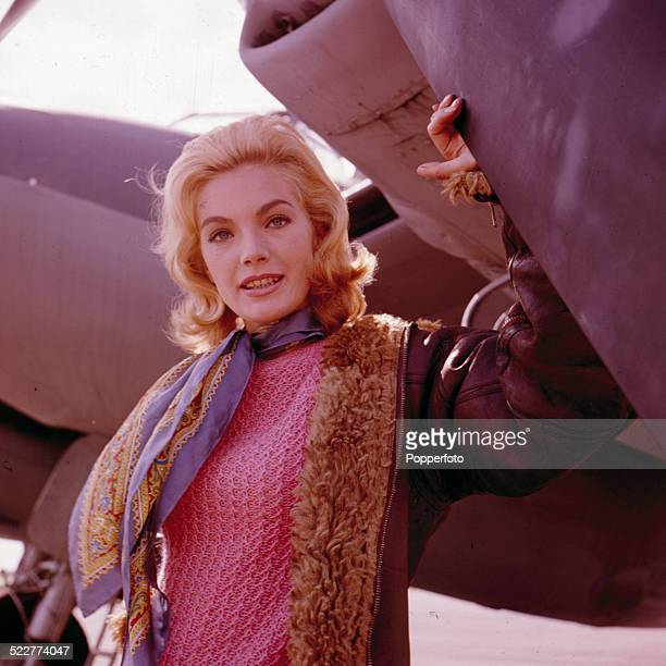 Austrian actress Maria Perschy pictured on location wearing a sheepskin lined leather jacket during production of the film '633 Squadron' in 1963