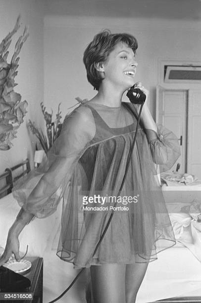 Austrian actress Nadja Tiller speaking over the phone in night gown during the 19th Venice International Film Festival Venice August 1958