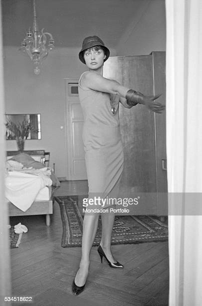 Austrian actress Nadja Tiller taking off a glove in a hotel room during the 19th Venice International Film Festival Venice August 1958
