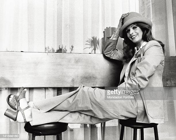 Austrian actress Senta Berger sitting Cannes 1973