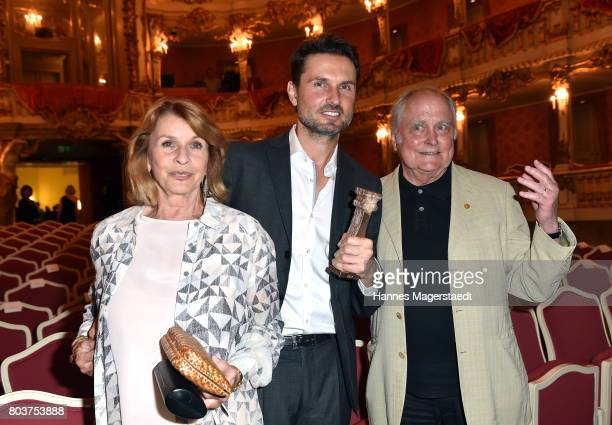 Austrian actress Senta Berger with her husband producer Michael Verhoeven and her son Simon Verhoeven attend the Bernhard Wicki Award 2017 during the...