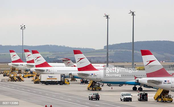 Austrian Airlines AG passenger aircraft sit on the tarmac at Vienna International Airport operated by Flughafen Wien AG in Vienna Austria on Friday...