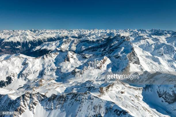 austrian alps in winter seen from plane