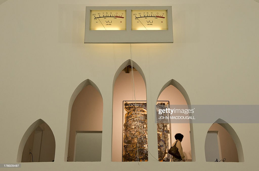 Austrian artist David Moises' 'Fluc-VU' (top) is on display at the Patrick Ebensperger Gallery, located in a former crematorium complex in Berlin's Wedding district, Germany on August 29, 2013. Built in 1912, the crematorium, now a protected landmark, was the first of its kind in what was then Prussia. The complex is expected to attract other galleries and art institutions.