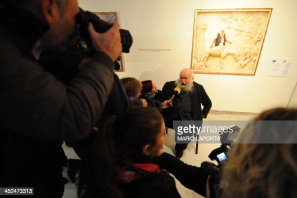 Austrian artist Herman Nitsch of TEAM[]niel poses by an image of himself superimposed on an erotic fresco at the Casoria Contemporary Art Museum near...