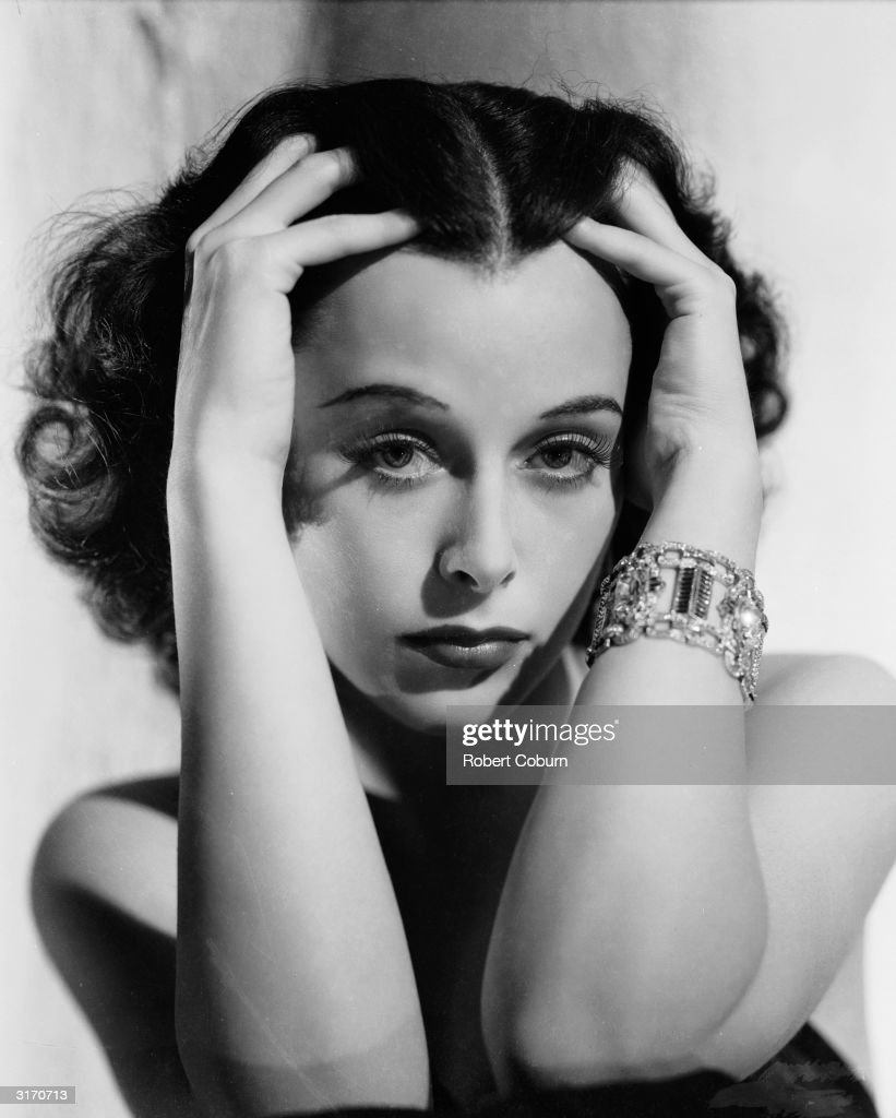 Austrian born actress <a gi-track='captionPersonalityLinkClicked' href=/galleries/search?phrase=Hedy+Lamarr&family=editorial&specificpeople=208868 ng-click='$event.stopPropagation()'>Hedy Lamarr</a> (1913 - 2000) clasping her head.
