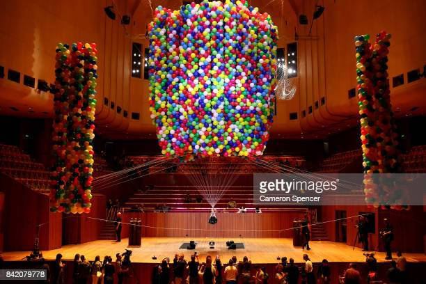 Austrian British artist Nomi Lakmaier is boundimmobilised and lifted by 20000 multicoloured party balloons during a nine hour performance on the...
