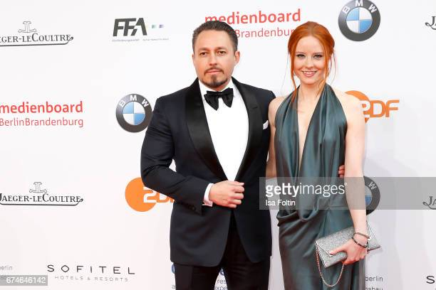 Austrian business man Klemens Hallmann and his girlfriend model Barbara Meier during the Lola German Film Award red carpet arrivals at Messe Berlin...