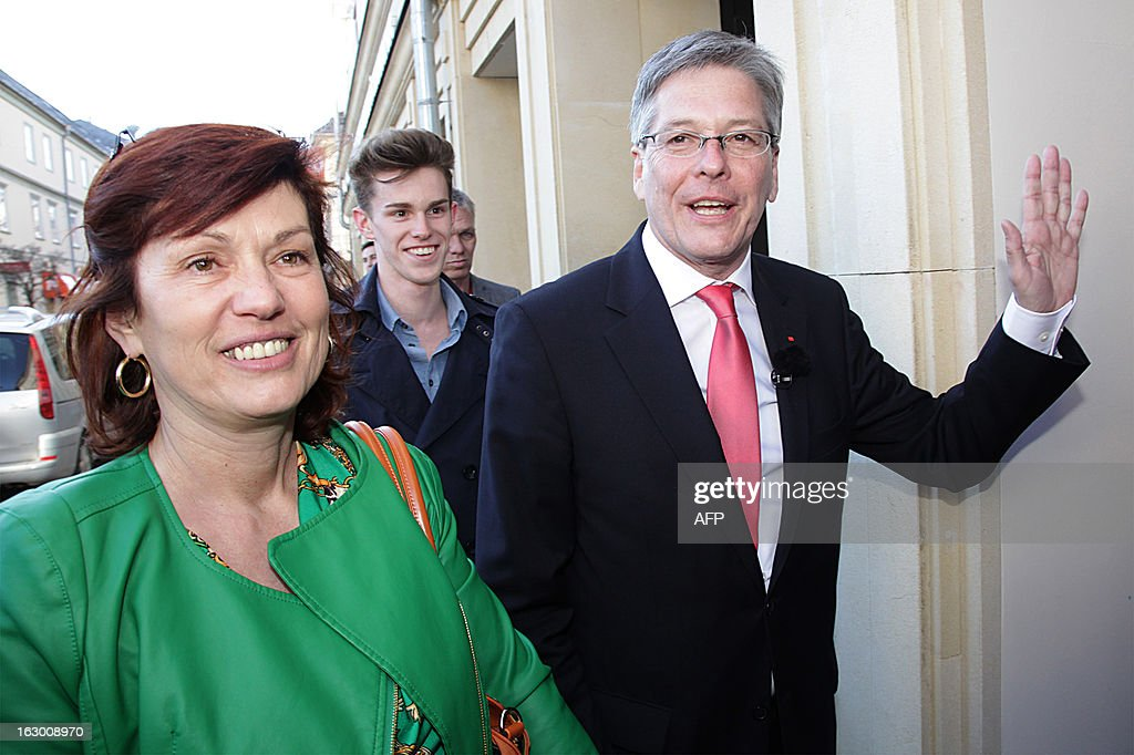 Austrian candidate of the Social Democrats Austria (SPOE) Peter Kaiser (R) waves as he arrives with his partner Uli Wehr for the regional elections in Kaernten, Austria on March 3, 2013. Austria's far-right on Sunday lost power in the state of Carinthia, its late leader Joerg Haider's former stronghold, projections from state election results showed.