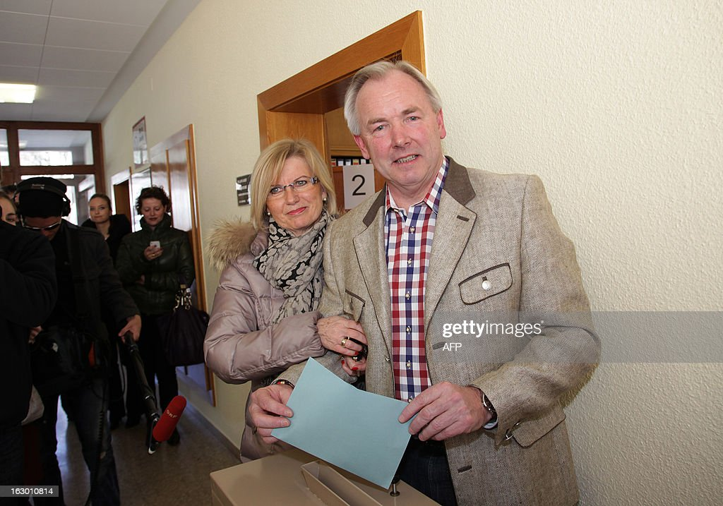 Austrian Carinthia's Governor Gerhard Doerfler casts his ballot next to his wife during the regional elections in Carinthia, Austria on March 3, 2013. Austria's far-right on Sunday lost power in the state of Carinthia, its late leader Joerg Haider's former stronghold, projections from state election results showed. AFP PHOTO / DANIEL RAUNIG