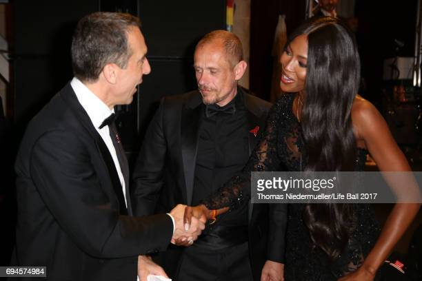 Austrian chancellor Christian Kern Gery Keszler and Naomi Campbell attend the Life Ball 2017 Gala Dinner at City Hall on June 10 2017 in Vienna...