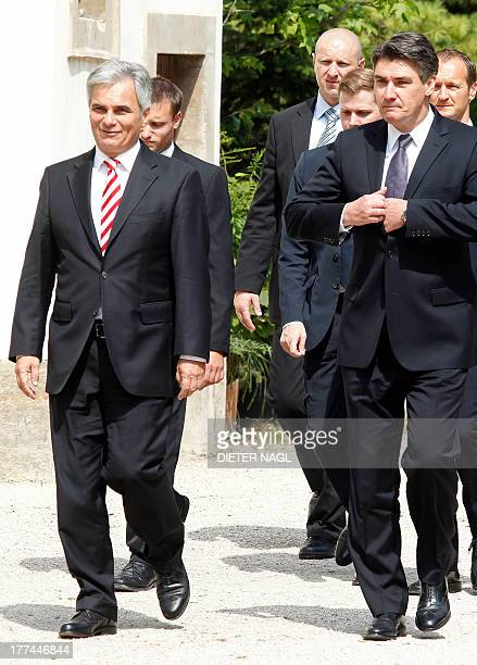 Austrian Chancellor Werner Faymann and Croatian Prime Minister Zoran Milanovic arrive for a joint meeting with the Slovenian Prime Minister in Graz...