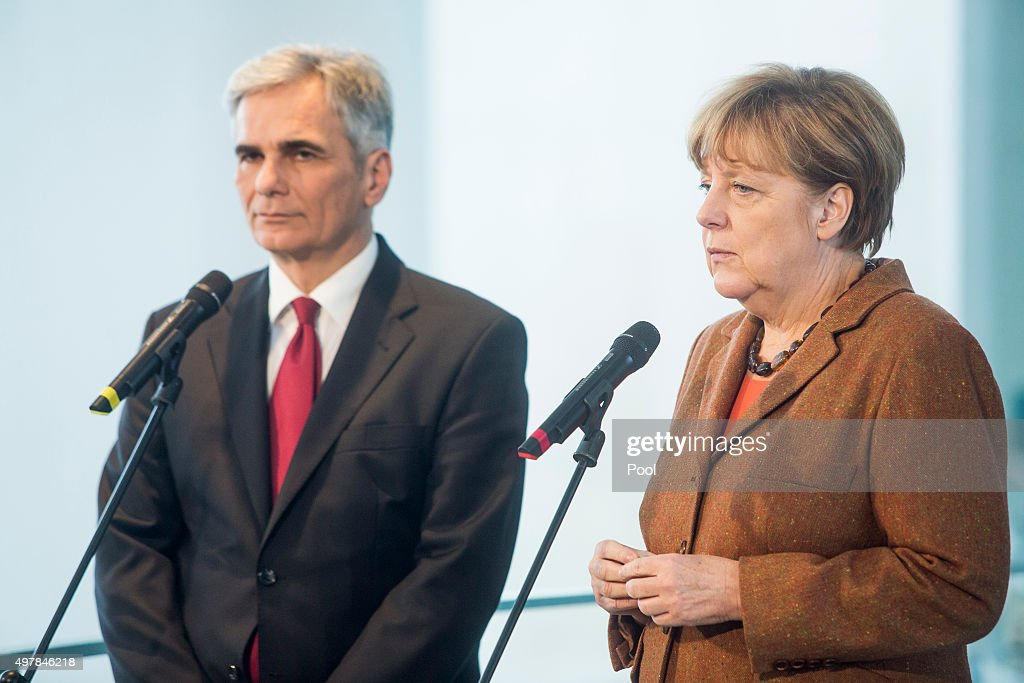 Austrian Chancellor Werner Faymann and German Chancellor Angela Merkel give a joint press conference at the German Chancellery on November 19, 2015 in in Berlin, Germany. Austrian Chancellor Faymann has called for more intensive border checks on migrants in the aftermath of the Paris attacks, as he and Chancellor Merkel also called for an increase in help amongst EU countries for the refugee crisis.